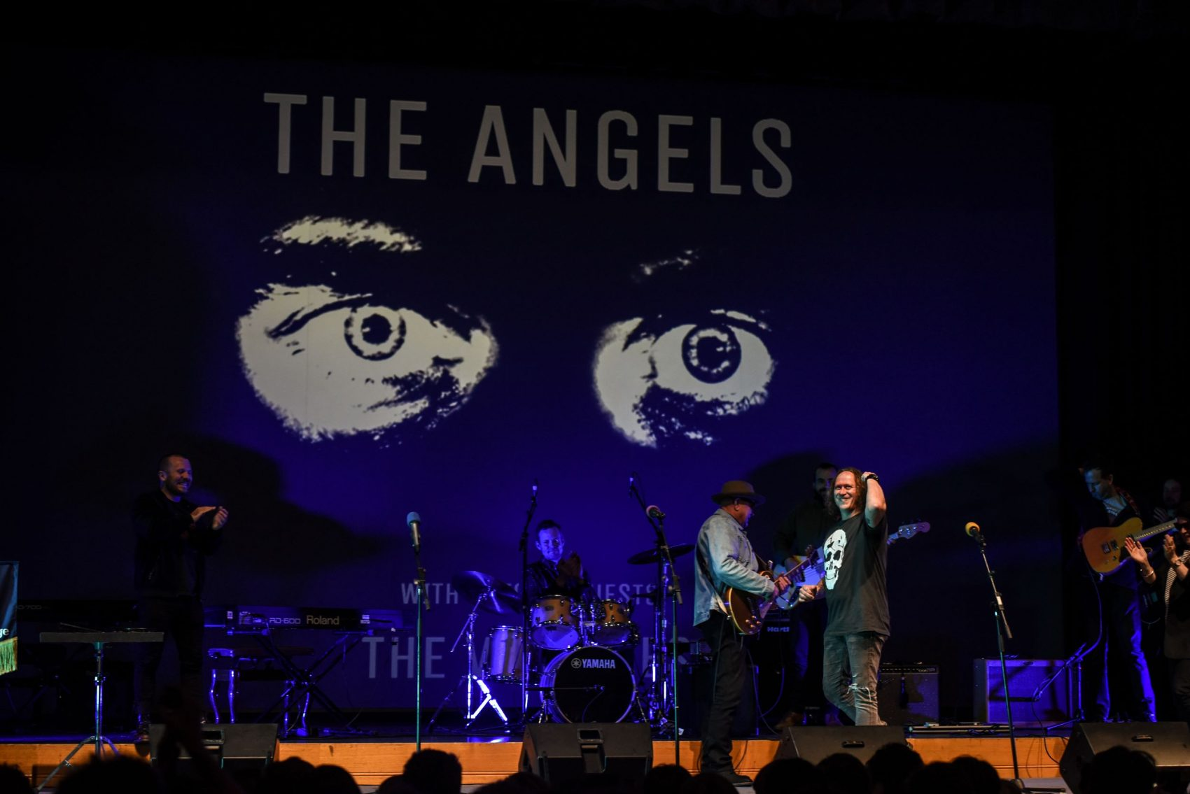 John Brewster and Dave Gleeson from 'The Angels' performing on stage at Battle of the Bands with St Peter's College staff members