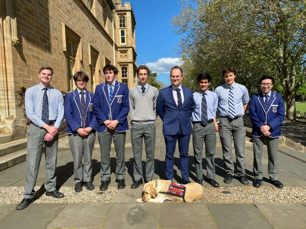 Student Teacher Jordan Box with his dog Sally and students he taught this term